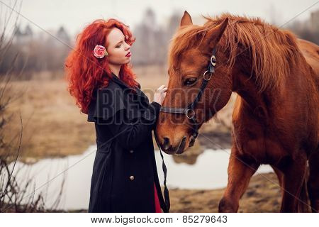 Red-haired Girl Stroking Horse.