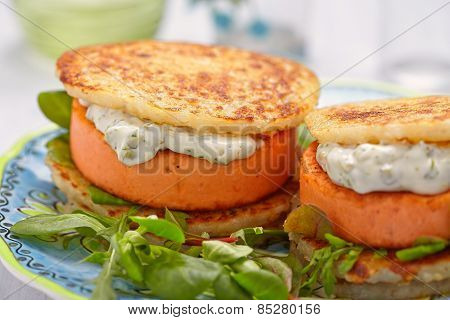 Salmon burger with potato pancakes