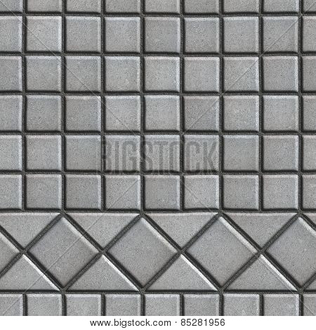 Grey Pave Slabs in the Form of Small Squares and Triangles.