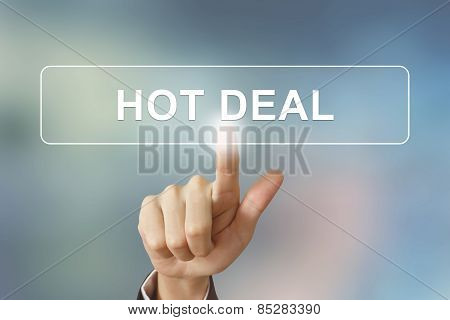 Business Hand Clicking Hot Deal Button On Blurred Background