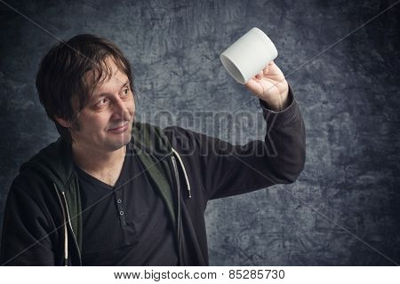 Disappointed Man Looking At Empty Cup