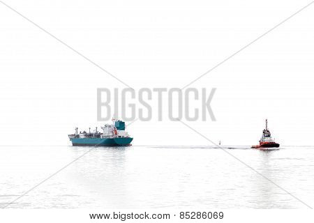 Tanker And Tug Silhouette