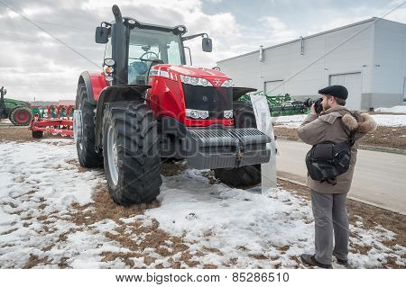 Photographer shoots tractor on exhibition