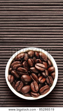 Coffee beans on bamboo floor