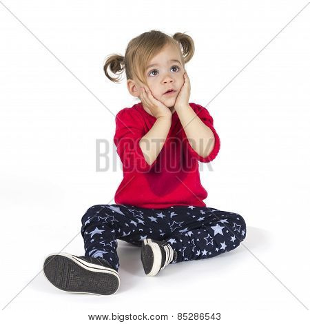 Baby girl sitting and make a gesture with hands