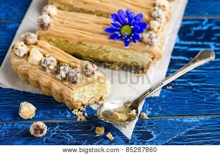 Walnut caramel tart  on a wooden background