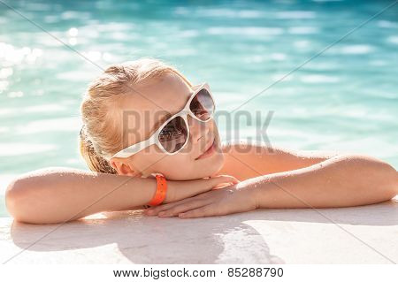 Beautiful Little Blond Girl With Sunglasses In Pool