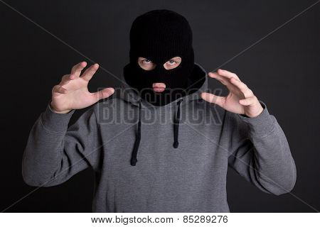 Angry Man Criminal, Robber Or Burglar In Black Mask Over Grey