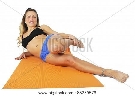 Young Sexy Attractive Fit Woman At Gym Doing Yoga Exercise And Stretching On Mat In Meditation And R