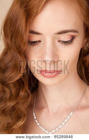 Portrait Of Woman With Curly Hairstyle And Beautiful Makeup
