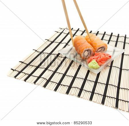 Woman's Hand With Chopsticks And Maki Sushi