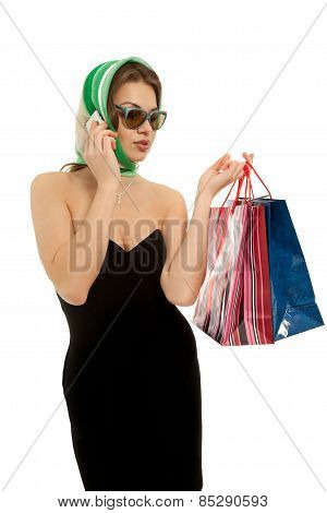 Beautiful Woman With Shopping Bags Calling By Phone Isolated