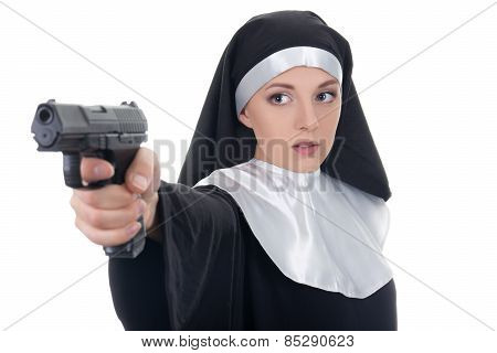 Young Woman Nun Shooting With Gun Isolated On White