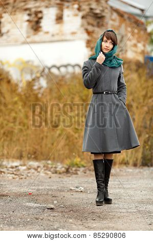 Beautiful Alone Woman  In Grey Coat Outdoors