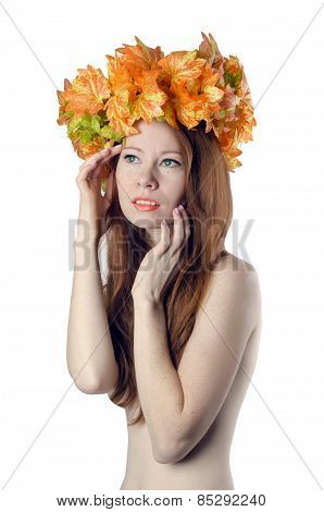 Topless Redhead Girl With A Wreath Of Colorful Flowers On Her Head