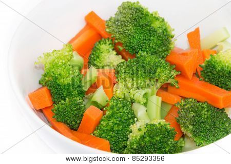 Fresh Carrots And Broccoli In A White Bowl