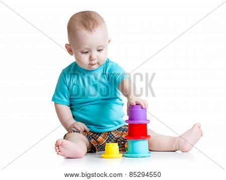 little boy playing with toys