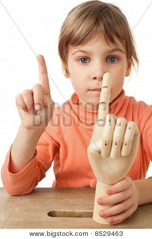 Pretty Little Girl Is Played By Wooden Hand Of Manikin Isolated On White Background, Two Forefingers