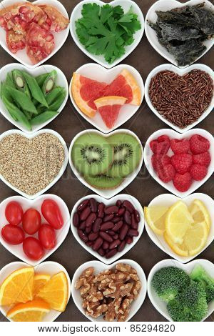 Diet detox super food selection in heart shaped porcelain bowls.
