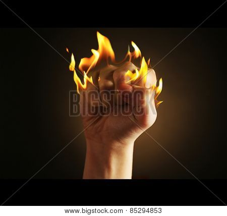 Burning fist isolated on black