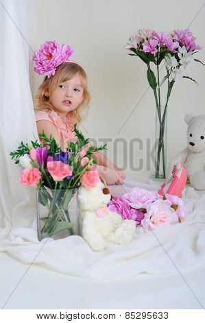 The Girl In A Pink Dress With A Flower On Her Head