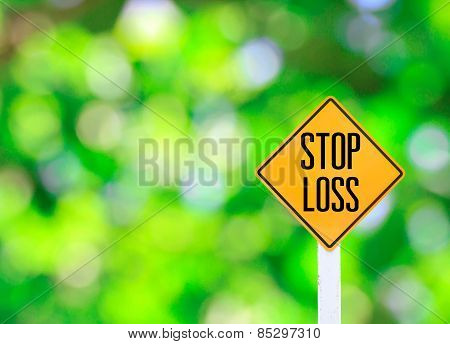 Yellow Traffic Sign Text For Stop Loss Green Bokeh Abstract Light Background