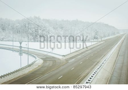Cold Winter Landscape Of A Road Through Forest