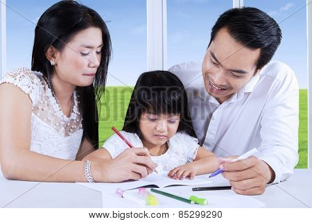 Parents Help Their Child To Write