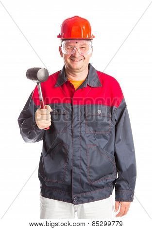 Worker holding hammer in hand.