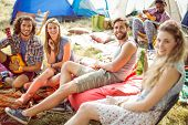 image of ukulele  - Hipsters having fun in their campsite at a music festival - JPG
