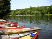 foto of dock a pond  - Line of Canoes at a walking dock on the Mount Gretna Lake in Pennsylvania - JPG