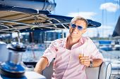 image of sailing vessel  - Handsome man relaxing on a sailing boat - JPG