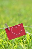 stock photo of clotheslines  - Cute heart Card hanging on the clothesline - JPG