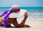 image of beach hat  - Beautiful woman on the beach with straw hat on the beach in Bali Indonesia - JPG