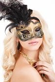 image of mystery  - Beautiful young woman in a mysterious gold Venetian mask - JPG