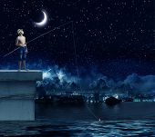foto of boys night out  - Young boy at night with fishing rod - JPG