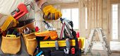 stock photo of plumber  - Builder handyman with construction tools - JPG