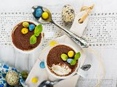 picture of easter candy  - Easter cream dessert tiramisu based in portioned cups are decorated sweet candy in the form of eggs - JPG