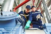 pic of manufacturing  - service engineer worker at industrial compressor refrigeration station repairing and adjusting equipment at manufacturing factory - JPG
