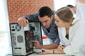 picture of teachers  - Teacher with student in technology repairing computer - JPG