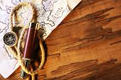 stock photo of spyglass  - Marine still life spyglass and world map on wooden background - JPG