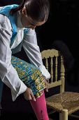 pic of bullfighting  - Woman bullfighter by dressing with vest on your back on a black background - JPG