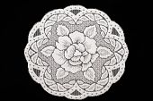 picture of doilies  - Handmade lace doily on a black background - JPG