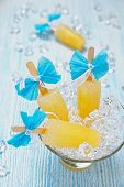 stock photo of popsicle  - Fruit ice cream popsicle in glass bowl - JPG