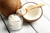 picture of exotic_food  - Coconut with coconut oil in jar on wooden background - JPG