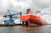 stock photo of fuel tanker  - Huge tanker ship moored to a wharf - JPG
