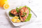 pic of plate fish food  - Tasty baked fish on plate on table close - JPG