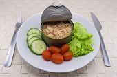 stock photo of cans  - Canned tuna serve on dish with salad for the concept of quick meal or healthy food  - JPG