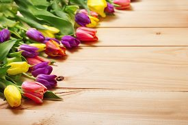 stock photo of invitation  - Spring Flowers bunch at wood floor texture - JPG