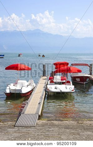 Red Catamarans In Geneva Lake Bay Harbor In Lausanne, Switzerland